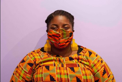 African American woman in colorful clothing with matching COVID-19 mask